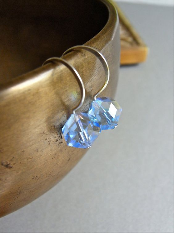 The Caerulea earrings consist of flashy sapphire hued vintage crystals on petite sterling ear wires - hand formed.  $21