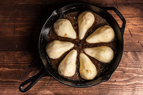 The cake in this recipe is baked upside down, then flipped to reveal caramelized pears nestled in a tender spice cake.