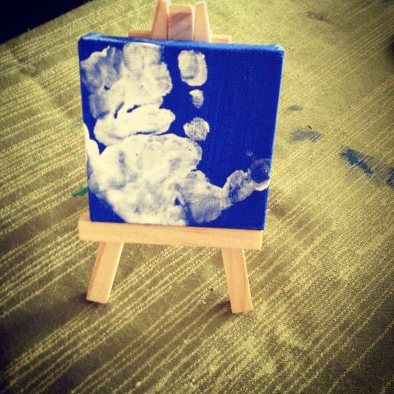 Baby handprint on little canvas with easel