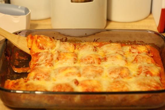 Baked Ravioli -I do this all the time. I add a layer of cream cheese and do meat and cheese raviolis....soooo yummy!!!