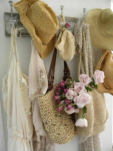 a little more vintage & shabby but loving the French feel to the hooks, the roses, the baskets and of course straw hats for down the beach