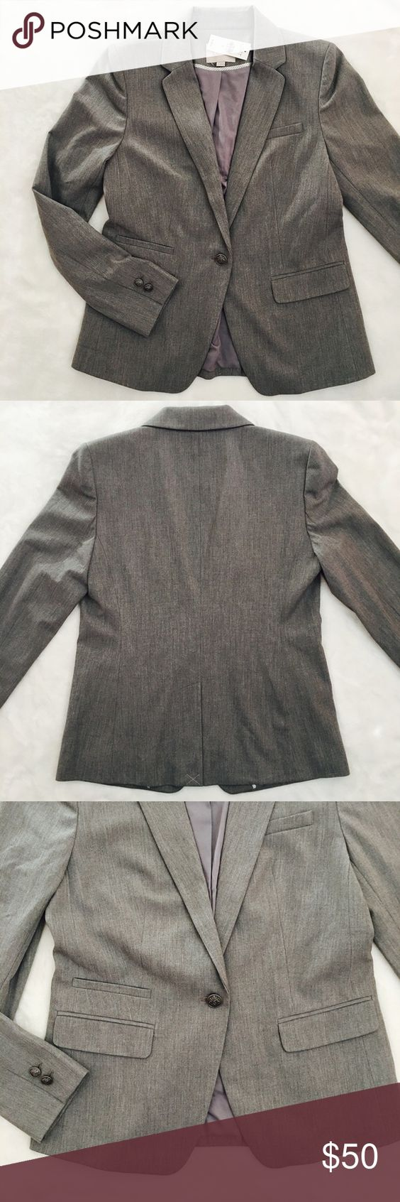 Loft Classic Blazer Grey ESSENTIAL NWT Loft blazer in grey. Gorgeous heathered grey, fully lined, notched lapels, silver crest buttons, 4 pocket styling. One breast pocket 3 front pockets. 62% polyester 33% rayon 5% spandex.   Fits 4-6 Bust 34-35 Waist 26.5-27.5 Hip 36-37 Sleeve 30.5-30.75 LOFT Jackets & Coats Blazers