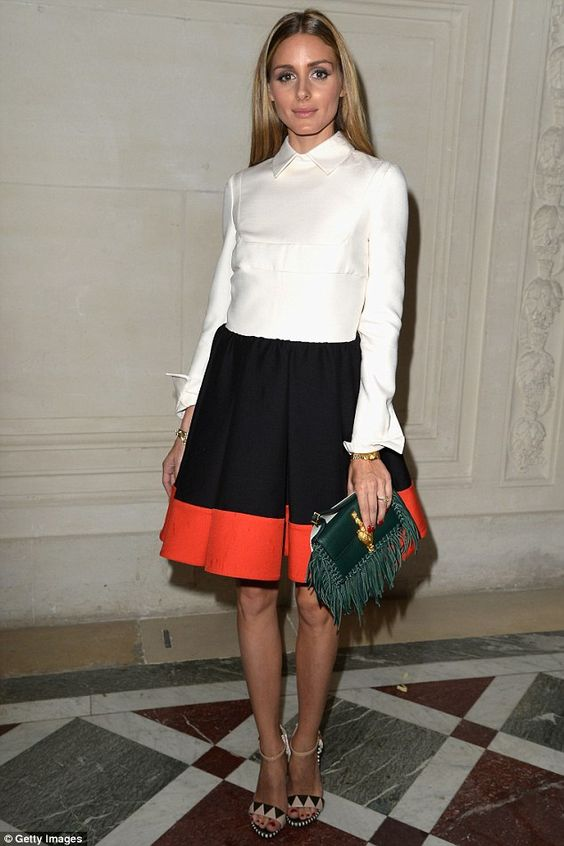 Olivia Palermo was stylish at the Valentino show in a tux inspired white shirt and flared skirt combination http://dailym.ai/1lUQCoS