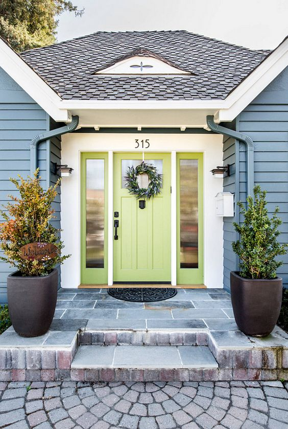 Front door paint colour in green. Curb appeal with blue siding #colorhunters #curbappeal