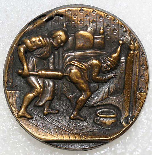 Antique brass button, man receiving an enema.