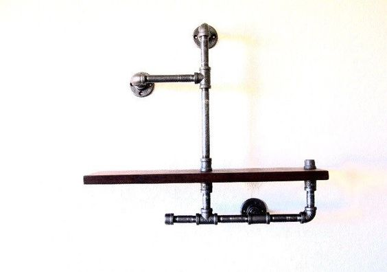 A personal favorite from my Etsy shop https://www.etsy.com/listing/489488608/urban-24-industrial-pipe-shelf-1x6-wood