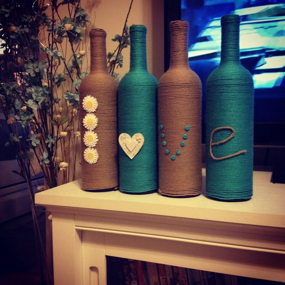 Yarn wrapped bottles.