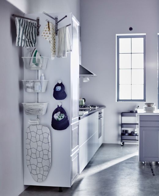 THE LAUNDRY ASSISTANT is a big help, especially if your washer and dryer are in the kitchen. There's room to hang dry, baskets to hold your iron and soaps, cloth bags to store hand wash items and a spot for an itty bity ironing board, too!