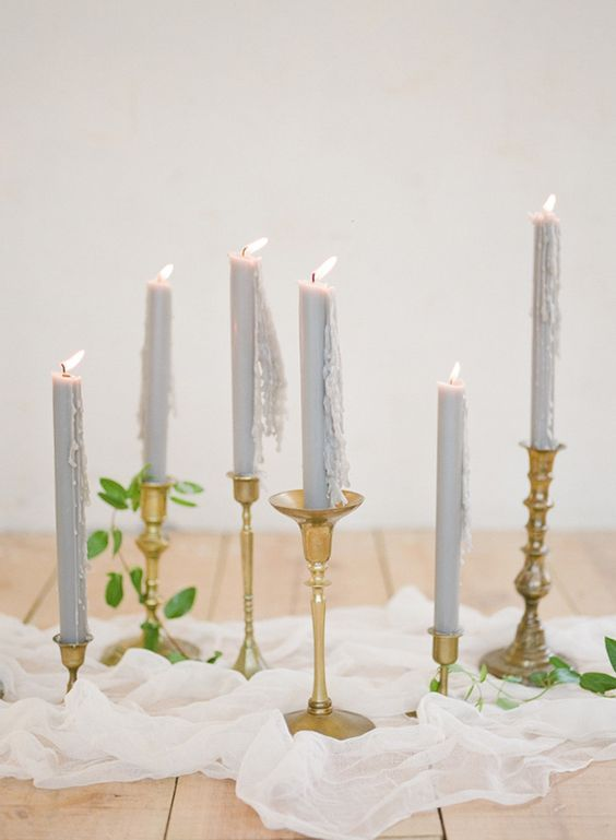 Pale Blue Taper Candles in Vintage Gold Holders | Feather and Stone Photography | http://heyweddinglady.com/dreamy-blue-latte-wedding-palette/