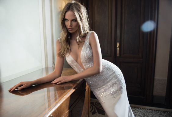 Glitz and glam brings a sense of grandeur to #Berta Style 15-112, created with metallic beading that that will dance under the lights. via @StrictlyWeddings