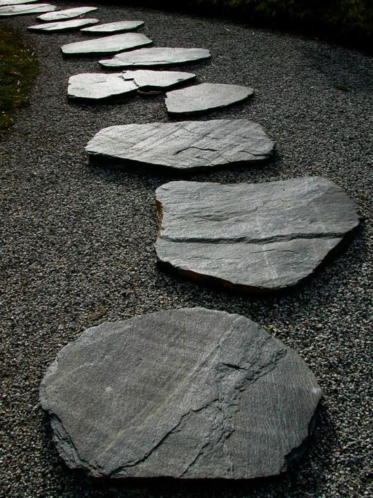 Rocks in a Japanese Zen garden represent islands, mountains, or other land mass. They symbolize calmness and mindfulness.