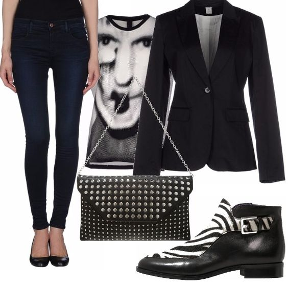 Abbinamento rock, jeans skinny, giacca nera e felpa con stampa in bianco e nero. Stivaletto zebrato bianco e nero. Borsa di pelle borchiata con tracolla a catena.
