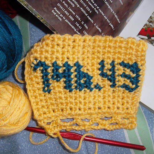 Does this yarn bombing tag make you want to visit the non-fiction shelves of your local public library?