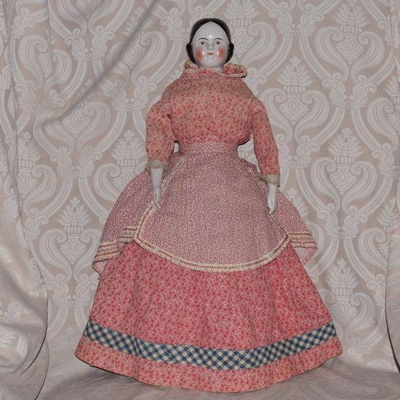 Kestner German Glazed Porcelain Brown Eye China Head Doll with Covered Wagon hair style, from joan-lynetteantiquedolls on Ruby Lane