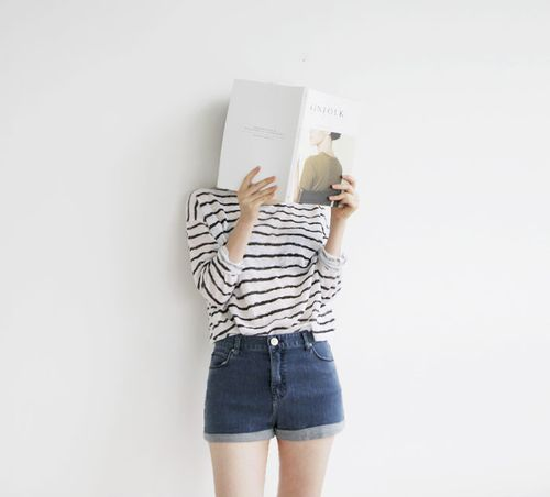 this is me. my face is always buried in a book and I am always wearing stripes w/ denim