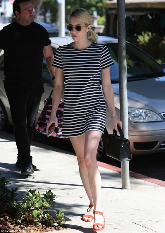 Leggy lady: Emma Roberts paraded her alabaster pins in a navy-striped T-shirt dress while out and about in West Hollywood on Saturday