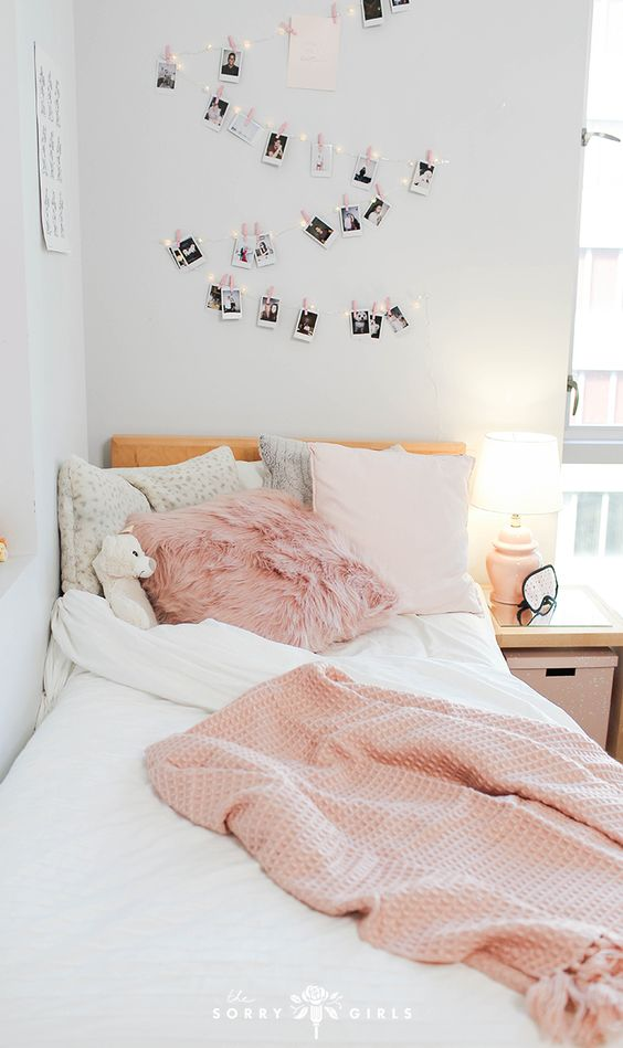 This dorm room is seriously a pink paradise! We had so much fun DIYing and making over this college dorm room! Click through to learn more!