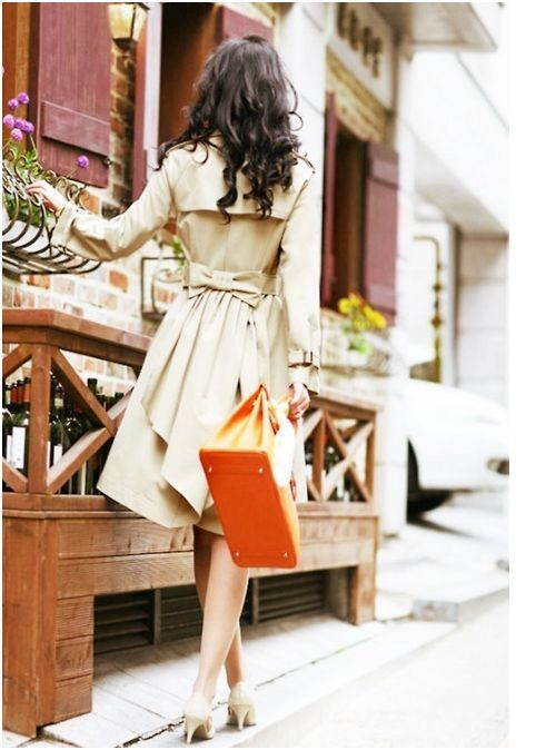 hair + bow back coat + orange bag