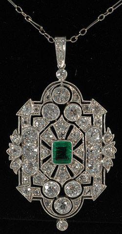 An Art Deco pendant set in platinum with emeralds and diamonds. #ArtDeco #pendant
