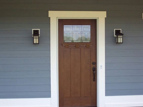 Front door I like. Pella Entry Door with Craftsmen Style Trim and Lighting. Siding is James Hardiplank Lap Siding color is boothbay blue.