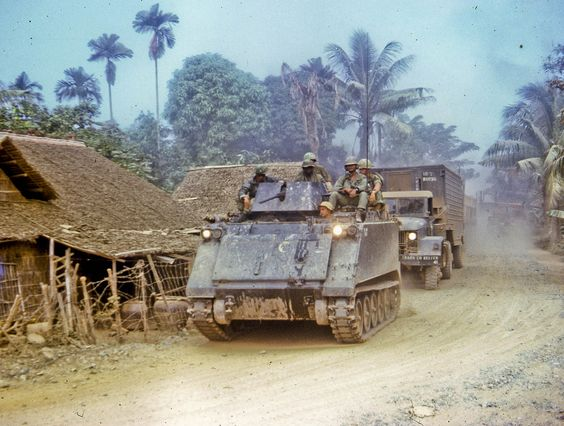"""Along the road between Dong Tam, """"home"""" to the 9th Infantry Division, and the city of My Tho in Dinh Tuong Province in Vietnam's Mekong delta in 1968. I shot this with an old Practiflex 35mm camera while riding in a 1 1/4 ton truck up this road."""" - Lance Nix photo, Nov 1968. ~ Vietnam War"""