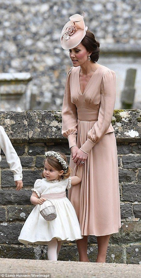Kate looked every bit the proud parent as she tended to her daughter today: