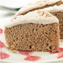 Apple Spice Cake - Chopped dried apples add texture and applesauce adds additional flavor to this favorite cake that's topped with cinnamon flavored white buttercream or cream cheese frosting.