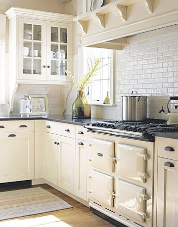 Cream colored cabinets colored cabinets and cabinets on for Cream colored cabinets