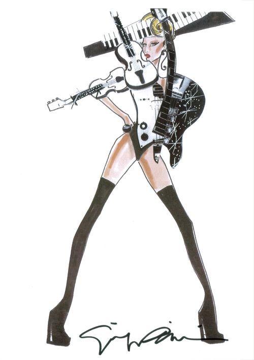 Did you know...that the designer's name behind Lady Gaga's more momentous stage costumes is...Giorgio Armani? La Gaga Vida!