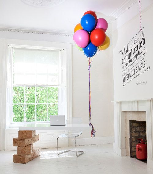 This is crazy!!! A balloon desk, supported on one side by permanent hot air balloons!