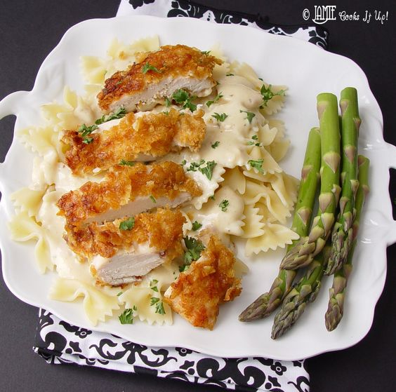 Crispy Chicken with Creamy Italian Sauce and Bowtie Pasta-Time: 45 minutes - Yield: 6 servings    3 large chicken breasts  5 C corn flakes  3/4 C flour  1/2 t salt  1/2 C milk  6 T olive oil    1   12 oz package bowtie noodles (farfalle)  Sauce:   1   10 oz container Philadelphia Cooking Cream (Italian Cheese and Herb Flavor)  2 cans cream of chicken soup  1 C chicken broth  1/2 C milk
