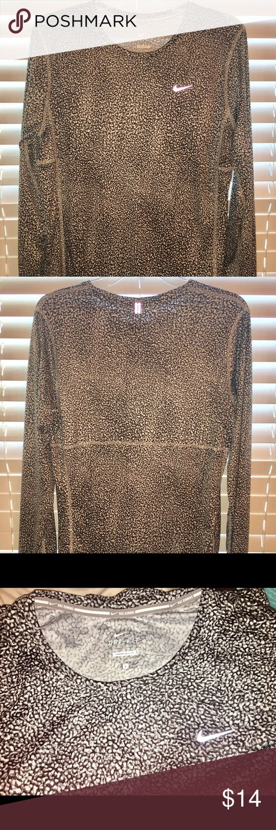 Nike Ladies DriFIT Long Sleeved Running shirt Nike ladies DriFIT Long Sleeved  running shirt.  100% Polyester.  DriFIT mesh fabric wicks away sweat do you help keep you dry and comfortable.  Reflective loop on the back of shirt helps keep media cords out of the way.  Like New - worn one time only! Nike Tops Tees - Long Sleeve
