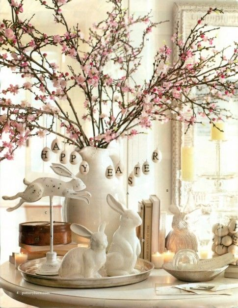 pink cherry blossom branches with white ceramic and wood bunnies for a pretty Easter or Spring inspired tablescape: