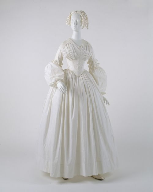 An American-made dress from circa 1840. This unusual sleeve shape was in vogue from approximately 1837 to 1843.