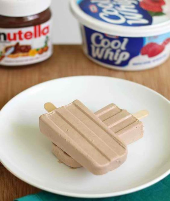 Here's how to make them (makes 6 servings): ~ Mix together 2 Cups of Cool Whip 6 tbsp. of Nutella 1 Cup of Milk ~ Pour into popcicle molds (can be bought at most dollar stores for $1) ~ Freeze for a few hrs, or overnight, then eat those yummy cool treats! Can also be made with the low fat Cool Whip and Skim Milk to reduce calories Not only is this fun and easy for the kids to make, but MUCH cheaper then buying the per-made popcicles they sell in stores