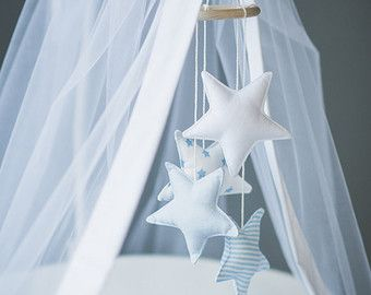 Nursery mobile Stars in mint and white. Baby mobile nursery decor made of wooden ring and stuffed tiny pillow stars.  This sweet Star mobile will interest your baby and be a beautiful decoration of a crib. This item is only for the mobile, other items - canopy, decorative pillows, bedding you can find in my shop: https://www.etsy.com/shop/CotandCot  For safety sake, keep the mobile out of your babys reach. -------------------------------------------------------------------...