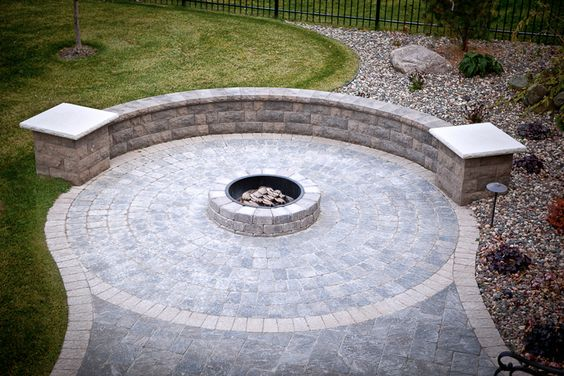Patio with sitting wall and built in fire pit.