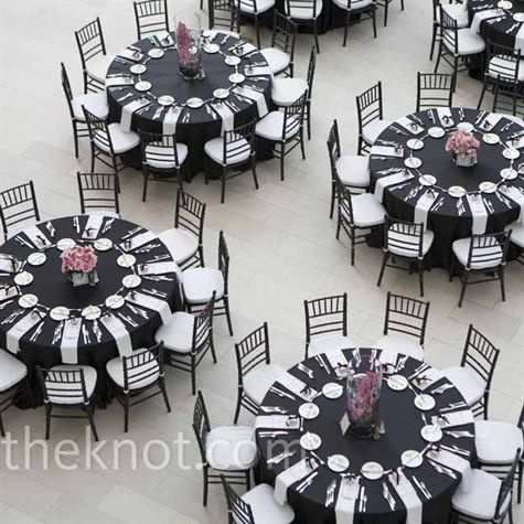 Black tablecloths surrounded by black ballroom chairs with white cushions set a stunning reception scene. | Wish list | Pinterest | Centerpieces ... & Black tablecloths surrounded by black ballroom chairs with white ...