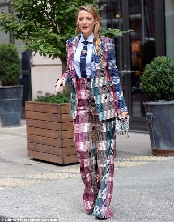 Feast of color: Blake stepped out in Manhattan wearing a striking checked high-waisted sui...