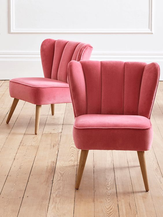 With a beautiful, full shape and stylish fluted back, our Westbury Velvet Chair in dusky rose pink is the ultimate in lounging shabby chic luxury. The pure cotton velvet cover shimmers gently when it catches the light, while the solid hardwood frame is padded with high resilience foam, interwoven with elasticated webbing for comfort and durability. The tapered legs are crafted from solid oak. aff link for cox and cox
