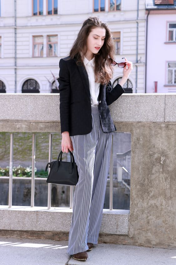 Fashion blogger Veronika Lipar of Brunette From Wall Street sharing fashionable business casual outfit in striped wide-leg pants and boyfriend blazer