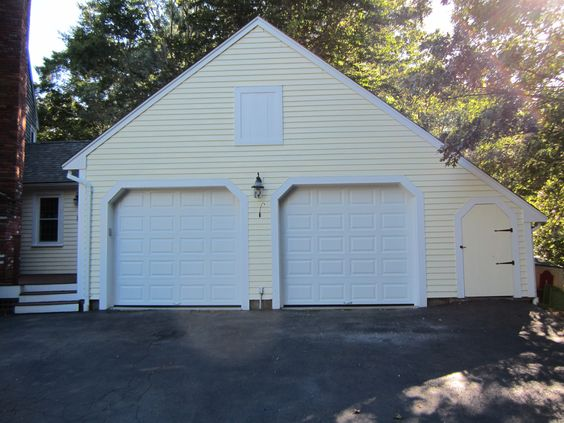 Residential garage doors raised panel and garage doors on for Clopay steel garage doors