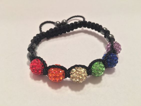 A personal favorite from my Etsy shop https://www.etsy.com/listing/271283819/shamballa-bracelet-gay-pride-colors-clay