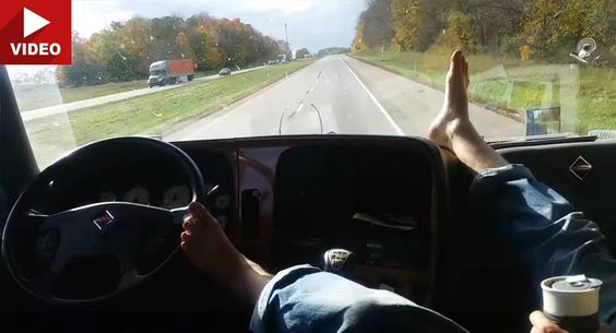 Watch Reckless Driver Steer Truck with Foot from the Passenger Seat on American Highway