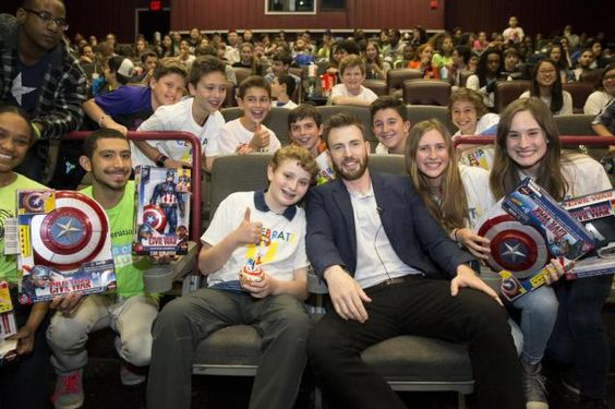 Chris Evans Goes to the Movies with #TeamCap Fans.