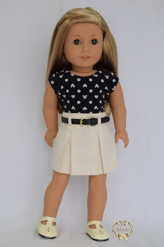 Item # 00027-14 This tee is one-of-a-kind item.    This product includes tee and skirt ( 2 pieces )  The doll, her earrings, and shoes are not