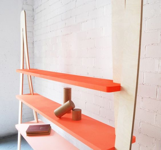 """GRADIENT BOOKCASE BY JORDI LOPEZ AGUILO.  The product comes flat packed and can be assembled in a few minutes. The shelves are made from steel frames and poplar plywood boards. Each leg is a flat piece of phenolic plywood that is bent during the assembly of the components."""" kutarq.com"""