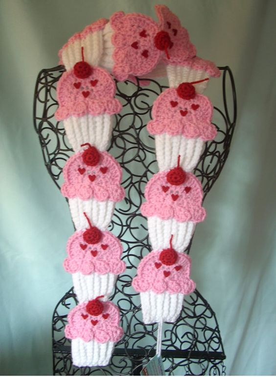Up for sale is one-  White cupcakes scarf with lt. pink frosting, red heart sprinkles topped with 3D stem cherries.    How many cupcakes in a