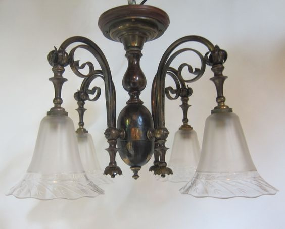 English flush fitting four arm ceiling light in the original patinated brass finish complemented by period satin and cut glass shades. c 1900  www.antiquelightingcompany.com