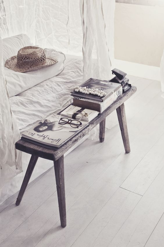 Bedroom decor with black and white bohemian decor. Design by Hannah Lemholt. Rustic bench at end of bed with white linens, photo by Hanna Lemholt. #bedroomdecor #bohemian #rusticdecor #farmbench #modernfarmhouse #whitedecor